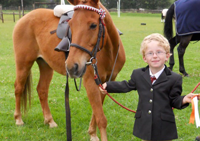 James_at_Dressage_Show_with_rosette_._10_395x280